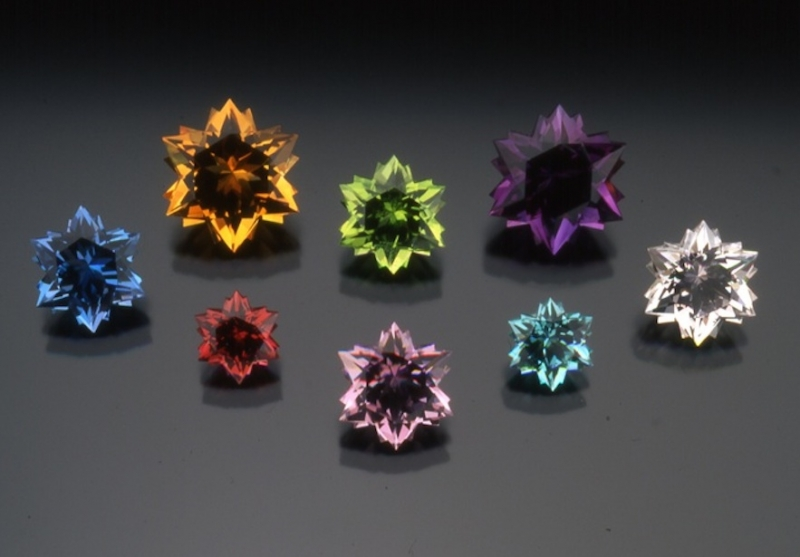 From left to right top row - Blue Topaz, Citrine, Peridot, Amethyst, Colourless Topaz